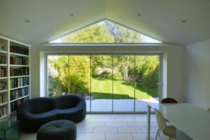 Frameless glass bifolding doors slide and pivot enabling flexible ventilation if required.