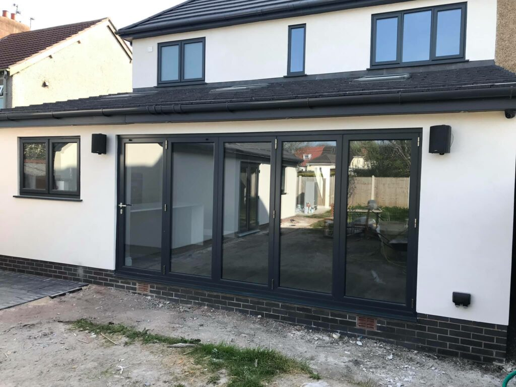 Grey Origin bifolding doors in an extension