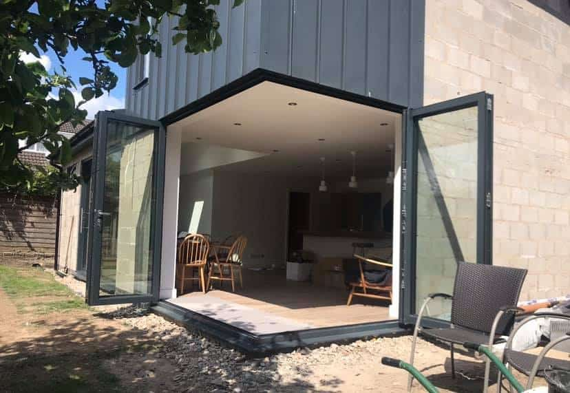 open corner bifolding and sliding doors in grey