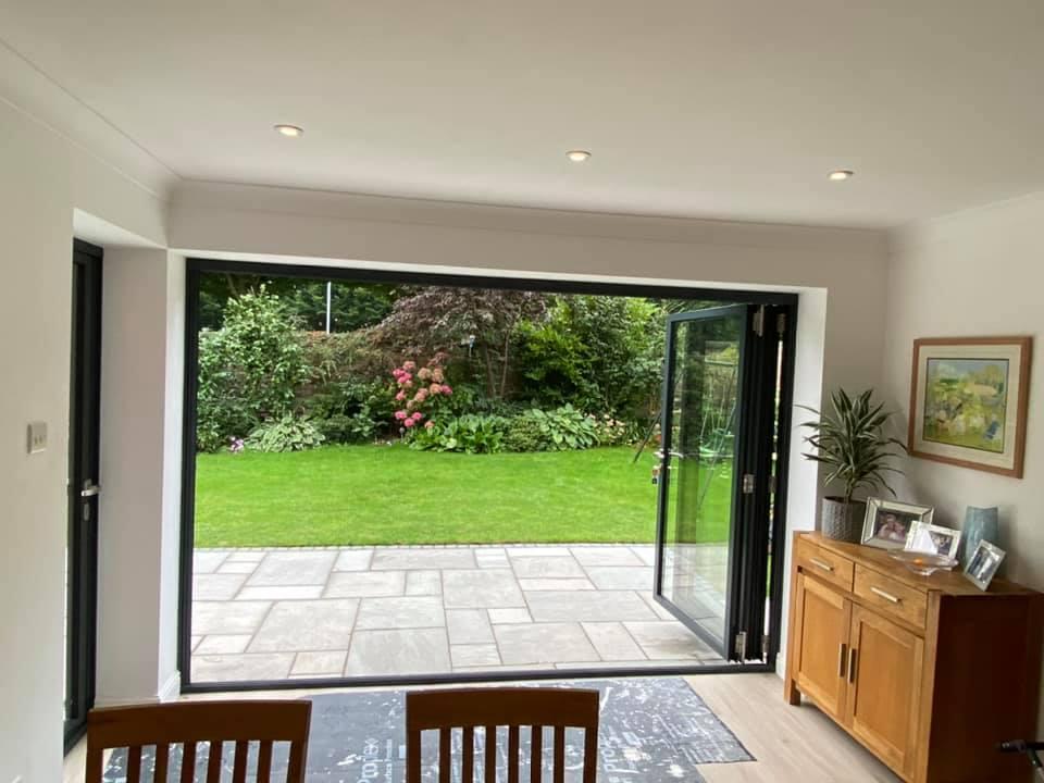 Open bifolding doors in Warrington house with garden views