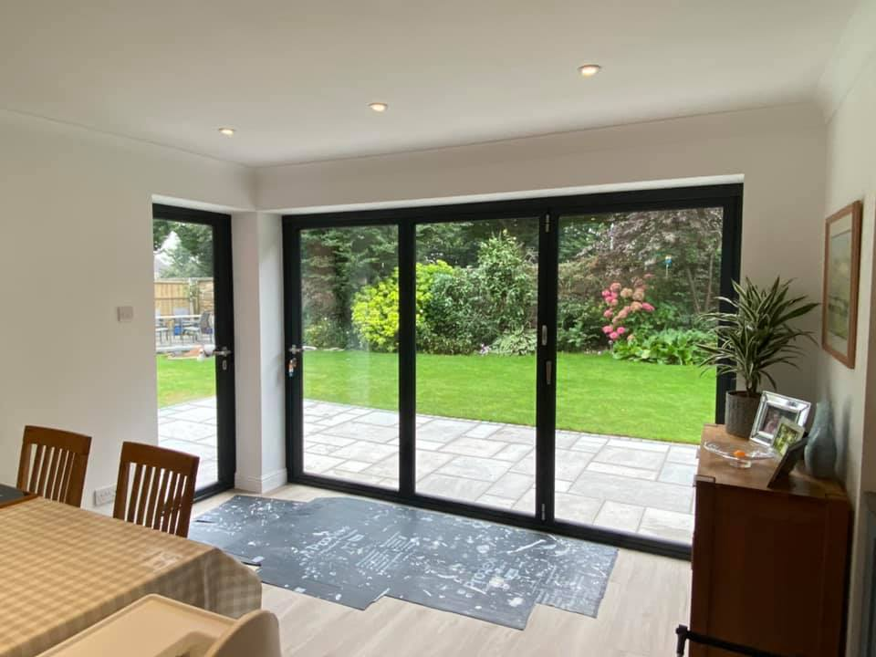 Grey origin bifolding doors in Warrington new build house